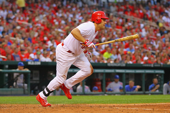 ST. LOUIS, MO - JUNE 17: Lance Berkman #12 of the St. Louis Cardinals hits a three-RBI double against the Kansas City Royals at Busch Stadium on June 17, 2011 in St. Louis, Missouri.  (Photo by Dilip Vishwanat/Getty Images)