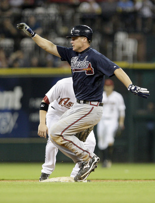 HOUSTON,TX - JUNE 11: Chipper Jones #10 of the Atlanta Braves slides in for a double in the tenth inning against the Houston Astros on June 11, 2011 at Minute Maid Park in Houston, Texas. Braves defeated the Astros 6 to 3 in ten innings. (Photo by Thomas