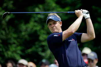 BETHESDA, MD - JUNE 18:  Luke Donald of England hits his tee shot on the fifth hole during the third round of the 111th U.S. Open at Congressional Country Club on June 18, 2011 in Bethesda, Maryland.  (Photo by Rob Carr/Getty Images)