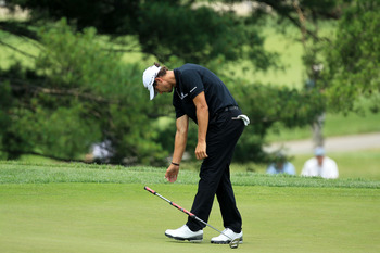 BETHESDA, MD - JUNE 16:  Adam Scott of Australia reacts to missing a birdie putt on the eigth green during the first round of the 111th U.S. Open at Congressional Country Club on June 16, 2011 in Bethesda, Maryland.  (Photo by David Cannon/Getty Images)