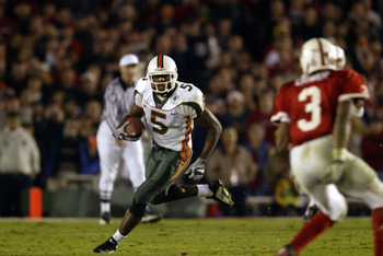 3 Jan 2002:  Andre Johnson #5 of Miami runs against the defense of Keyuo Craver #3 of Nebraska during the Rose Bowl National Championship game at the Rose Bowl in Pasadena, California.  Miami won the game 37-14, winning the BCS and the National Championsh