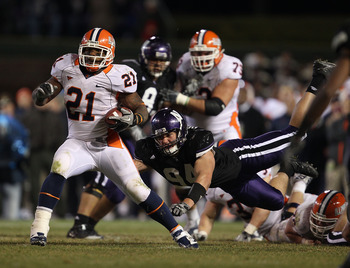 CHICAGO - NOVEMBER 20: Jason Ford #21 of the Illinois Fighting Illini breaks away from Vince Browne #94 of the Northwestern Wildcats during a game played at Wrigley Field on November 20, 2010 in Chicago, Illinois. Illinois defeated Northwestern 48-27. (Ph