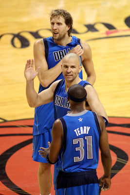 MIAMI, FL - JUNE 12: (From top) Dirk Nowitzki #41, Jason Kidd #5 and Jason Terry #31 of the Dallas Mavericks celebrate against the Miami Heat in Game Six of the 2011 NBA Finals at American Airlines Arena on June 12, 2011 in Miami, Florida. NOTE TO USER: U