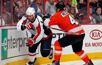 PHILADELPHIA, PA - MARCH 22:  Dennis Wideman #6 of the Washington Capitals is checked by Andrej Meszaros #41 of the Philadelphia Flyers during an NHL hockey game at the Wells Fargo Center on March 22, 2011 in Philadelphia, Pennsylvania.  (Photo by Paul Be