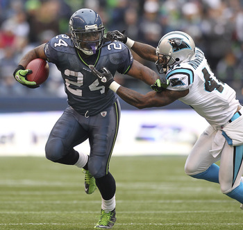 SEATTLE, WA - DECEMBER 05:  Running back Marshawn Lynch #24 of the Seattle Seahawks rushes against Captain Munnerlyn #41 of the Carolina Panthers at Qwest Field on December 5, 2010 in Seattle, Washington. The Seahawks defeated the Panthers 31-14. (Photo b