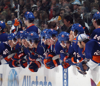UNIONDALE, NY - APRIL 08:  The New York Islanders watch the shoot out against the Pittsburgh Penguins with their helmets on backwards for good luck at the Nassau Coliseum on April 8, 2011 in Uniondale, New York.  (Photo by Bruce Bennett/Getty Images)