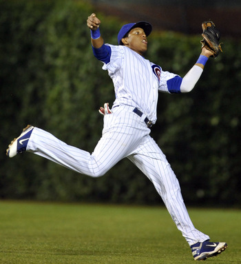 CHICAGO, IL - JUNE 15:  Starlin Castro # 13 of the Chicago Cubs catches a line drive the Milwaukee Brewers on June 15, 2011 at Wrigley Field in Chicago, Illinois.  (Photo by David Banks/Getty Images)