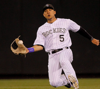 DENVER, CO - JUNE 18:  Center fielder Carlos Gonzalez #5 of the Colorado Rockies makes a sliding catch off the bat of Jhonny Peralta #27 of the Detroit Tigers for the second out of the eighth inning at Coors Field on June 18, 2011 in Denver, Colorado.  (P