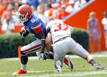 GAINESVILLE, FL - SEPTEMBER 04:  Pat Hinkel #37 of the Miami University RedHawks attempts to tackle Deonte Thompson #6 of the Florida Gators at Ben Hill Griffin Stadium on September 4, 2010 in Gainesville, Florida.  (Photo by Sam Greenwood/Getty Images)