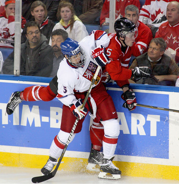 BUFFALO, NY - DECEMBER 28: Martin Frk #5 of the Czech Republic checks Erick Gudbranson #5 of Canada during the 2011 IIHF World U20 Championship game between Canada and the Czech Republic at the HSBC Arena on December 28, 2010 in Buffalo, New York. Canada
