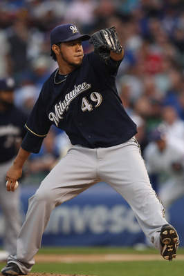 CHICAGO, IL - JUNE 14:  Starting pitcher Yovani Gallardo #49 of the Milwaukee Brewers delivers the ball against the Chicago Cubs at Wrigley Field on June 14, 2011 in Chicago, Illinois.  The Cubs defeated the Brewers 5-4 in 10 innings.  (Photo by Jonathan