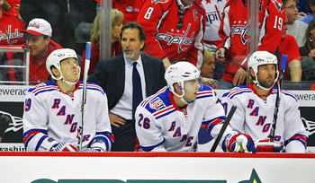 WASHINGTON, DC - APRIL 23:  Ruslan Fedotenko #19, Head Coach John Tortorella, Erik Christensen #26 and Vinny Prospal #20 of the New York Rangers appear dejected as they loose to the Washington Capitals 3-1 in Game Five of the Eastern Conference Quarterfin