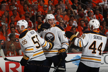 PHILADELPHIA, PA - APRIL 26:  Tyler Myers #57 of the Buffalo Sabres celebrates his third period goal against the Philadelphia Flyers with teammates Jochen Hecht #55 and Andrej Sekera #44 in Game Seven of the Eastern Conference Quarterfinals during the 201
