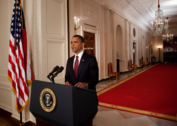 WASHINGTON, DC - MAY 1:  (AFP OUT) U.S. President Barack Obama stands after addressing the nation on TV from the East Room of the White House to make a televised statement May 1, 2011 in Washington, DC.  Bin Laden has been killed near Islamabad, Pakistan