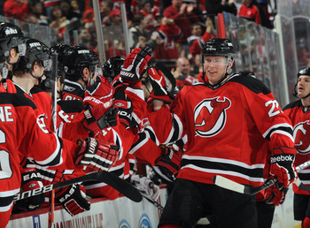 NEWARK, NJ - APRIL 10:  Alexander Urbom #22 of the New Jersey Devils celebrates his first NHL goal at 9:10 of the third period against the Boston Bruins at the Prudential Center on April 10, 2011 in Newark, New Jersey. The Devils defeated the Bruins 3-2.