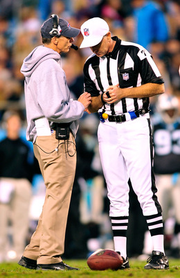 CHARLOTTE, NC - OCTOBER 25:  Coach Dick Jauron of the Buffalo Bills confers with an official during a game against the Carolina Panthers at Bank of America Stadium on October 25, 2009 in Charlotte, North Carolina. Buffalo won 20-9.  (Photo by Grant Halver