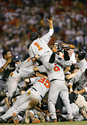 OMAHA, NE - JUNE 24:  Joey Wong #1 of the Oregon State Beavers leaps on top of the pile as his team celebrates winning their second straight NCAA Championship after defeating the North Carolina Tar Heels 9-3 in Game 2 of the NCAA College World Series Cham