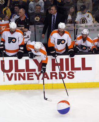 BOSTON, MA - MAY 06:  BOSTON, MA - MAY The Philadelphia Flyers try to capture a ball that was tossed on the ice in the third period against the Boston Bruins in Game Four of the Eastern Conference Semifinals during the 2011 NHL Stanley Cup Playoffs at TD