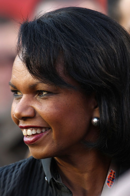 MIAMI GARDENS, FL - FEBRUARY 07:  Former Secretary of State Condoleezza Rice watches warms-ups on the field prior to the start of Super Bowl XLIV between the Indianapolis Colts and the New Orleans Saints on February 7, 2010 at Sun Life Stadium in Miami Ga