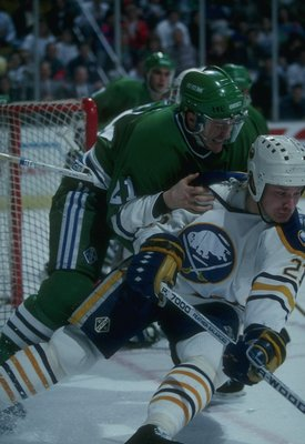 Christian Ruuttu of the Buffalo Sabres is checked by a member of the Hartford Whalers at the Memorial Auditorium in Buffalo, New York.