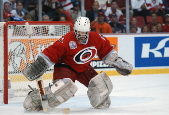 DETROIT, MI - JUNE 13:  Goaltender Arturs Irbe #1 of the Carolina Hurricanes blocks a shot from Sergei Fedorov #91 of the Detroit Red Wings during the first period of game five of the NHL Stanley Cup Finals on June 13, 2002 at the Joe Louis Arena in Detro