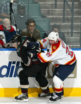 30 Jan 02 : Robert Svehla #24 of the Florida Panthers pressures Daniel Briere #8 of the Phoenix Coyotes during the game at National Car Rental Center in Sunrise, Florida. The Coyotes beat the Panthers 3-1. DIGITAL IMAGE. Mandatory Credit: Eliot Schechter/