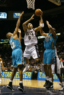 EAST RUTHERFORD, NJ - NOVEMBER 18:  Kenyon Martin #6 of the New Jersey Nets shoots over Jamaal Magloire #21 and P.J. Brown #42 of the New Orleans Hornets on November 18, 2003 at Continental Airlines Arena in East Rutherford, New Jersey.   NOTE TO USER: Us