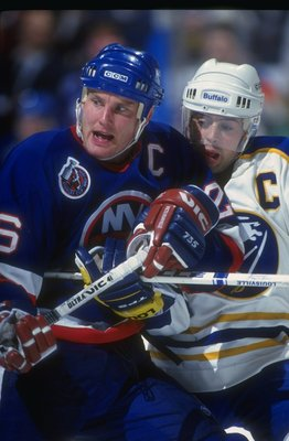 BUFFALO, NY - DECEMBER 4: Dec 1992: Rightwinger Patrick Flatley #15 of the New York Islanders works against Pat LaFontaine #16 of the Buffalo Sabres during their game on December 4, 1992 at the Memorial Auditorium in Buffalo, New York.  (Photo by Rick Ste
