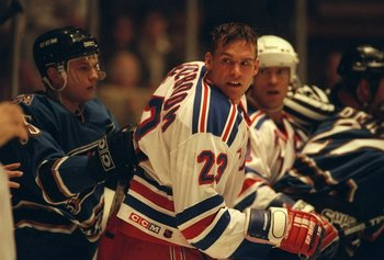 18 Dec 1995: Defenseman Sergei Gonchar of the Washington Capitals and defenseman Jeff Beukeboom of the New York Rangers look on during a game played at Madison Square Garden in New York, New York. The Rangers won the game, 3-0.