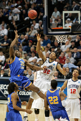 DENVER, CO - MARCH 19:  Kenneth Faried #35 of the Morehead State Eagles shoots over Justin Harper #32 of the Richmond Spiders during the third round of the 2011 NCAA men's basketball tournament at Pepsi Center on March 19, 2011 in Denver, Colorado.  (Phot