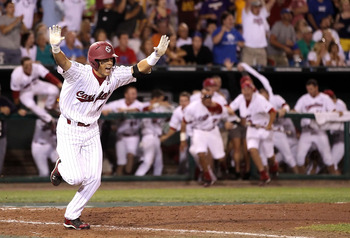 OMAHA, NE - JUNE 29:  Whit Merrifield #5 of the South Carolina Gamecocks celebrates after hitting the game winning RBI to defeat the UCLA Bruins in game 2 of the men's 2010 NCAA College Baseball World Series at Rosenblatt Stadium on June 29, 2010 in Omaha
