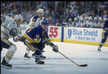 3 Jan 1992:  Center Craig Janney of the St. Louis Blues moves the puck during a game against the Buffalo Sabres at Memorial Auditorium in Buffalo, New York. Mandatory Credit: Rick Stewart  /Allsport
