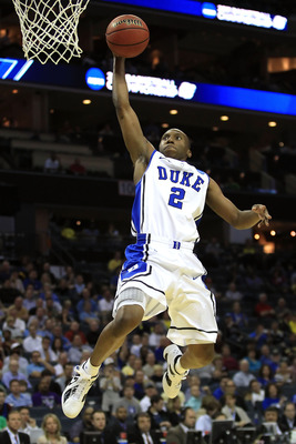 CHARLOTTE, NC - MARCH 18:  Nolan Smith #2 of the Duke Blue Devils dunks the ball in the second half while taking on the Hampton Pirates during the second round of the 2011 NCAA men's basketball tournament at Time Warner Cable Arena on March 18, 2011 in Ch