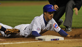 CHICAGO, IL - JUNE 13: Darwin Barney  # 15 of the Chicago Cubs slides into third base against the Milwaukee Brewers on June 13, 2011 at Wrigley Field in Chicago, Illinois. The Cubs defeated the Brewers 1-0.  (Photo by David Banks/Getty Images)