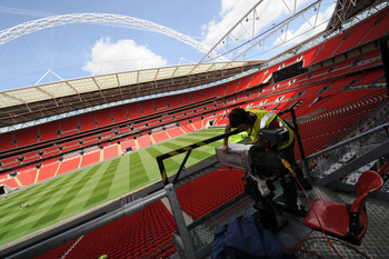 LONDON, UNITED KINGDOM - MAY 24:  In this handout image provided by UEFA, final preparations are made to television cameras at Wembley Stadium for the Champions League Final, May 24, 2011  in London, England. The UEFA Champions League final between FC Bar