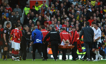 Stuart Holden being stretchered off in Mid March