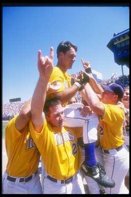 8 Jun 1996: Warren Morris of the Miami Hurricanes rides on top of his teammates after winning a playoff game against the Louisville Cardinals at Rosenblatt Stadium in Omaha, Nebraska. The Hurricanes won the game 8 - 3.