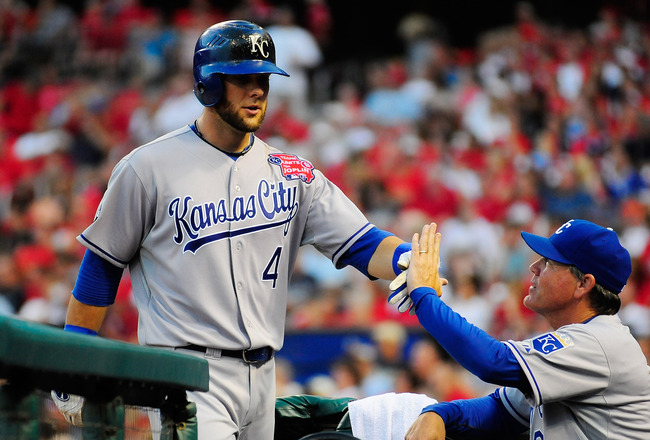 ST. LOUIS, MO - JUNE 18: Alex Gordon #4 of the Kansas City Royals high fives Ned Yost #3 after hitting a solo home run against the St. Louis Cardinals at Busch Stadium on June 18, 2011 in St. Louis, Missouri.  (Photo by Jeff Curry/Getty Images)