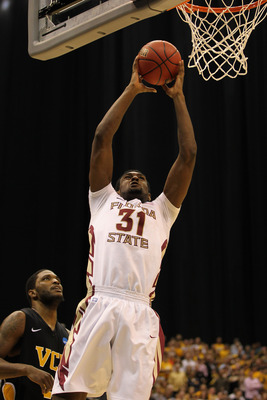SAN ANTONIO, TX - MARCH 25:  Chris Singleton #31 of the Florida State Seminoles goes to the basket against Jamie Skeen #21 of the Virginia Commonwealth Rams during the southwest regional of the 2011 NCAA men's basketball tournament at the Alamodome on Mar