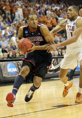TULSA, OK - MARCH 20:  Derrick Williams #23 of the Arizona Wildcats drives with the ball against Gary Johnson #1 of the Texas Longhorns during the third round of the 2011 NCAA men's basketball tournament at BOK Center on March 20, 2011 in Tulsa, Oklahoma.