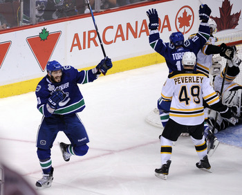 VANCOUVER, BC - JUNE 10:  Maxim Lapierre #40 of the Vancouver Canucks celebrates after scoring a goal in the third period against the Boston Bruins during Game Five of the 2011 NHL Stanley Cup Final at Rogers Arena on June 10, 2011 in Vancouver, British C