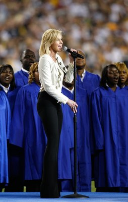 TAMPA, FL - FEBRUARY 01:  Singer Faith Hill performs 'America the Beautiful' during the pre-game show prior to the start of Super Bowl XLIII between the Arizona Cardinals and the Pittsburgh Steelers on February 1, 2009 at Raymond James Stadium in Tampa, F
