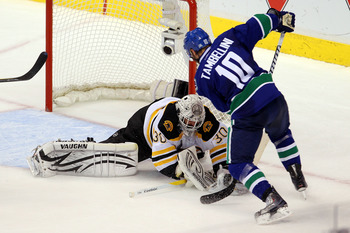 VANCOUVER, BC - JUNE 15:  Tim Thomas #30 of the Boston Bruins makes a save against Jeff Tambellini #10 of the Vancouver Canucks during Game Seven of the 2011 NHL Stanley Cup Final at Rogers Arena on June 15, 2011 in Vancouver, British Columbia, Canada.  (
