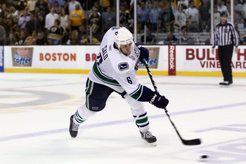 BOSTON, MA - JUNE 08:  Sami Salo #6 of the Vancouver Canucks takes a slap shot against the Boston Bruins during Game Four of the 2011 NHL Stanley Cup Final at TD Garden on June 8, 2011 in Boston, Massachusetts.  (Photo by Elsa/Getty Images)