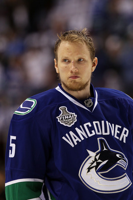 VANCOUVER, BC - JUNE 10:  Christian Ehrhoff #5 of the Vancouver Canucks looks on during Game Five of the 2011 NHL Stanley Cup Final at Rogers Arena on June 10, 2011 in Vancouver, British Columbia, Canada.  (Photo by Bruce Bennett/Getty Images)