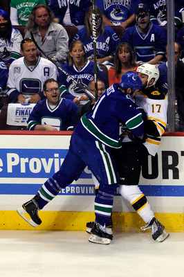 VANCOUVER, BC - JUNE 10:  Andrew Alberts #41 of the Vancouver Canucks checks Milan Lucic #17 of the Boston Bruins during Game Five of the 2011 NHL Stanley Cup Final at Rogers Arena on June 10, 2011 in Vancouver, British Columbia, Canada.  (Photo by Rich L