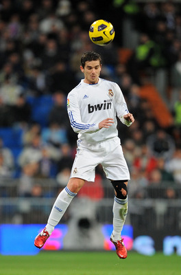 MADRID, SPAIN - JANUARY 23: Fernando Gago of Real Madrid heads the ball during the La Liga match between Real Madrid and Mallorca at Estadio Santiago Bernabeu on January 23, 2011 in Madrid, Spain.  (Photo by Denis Doyle/Getty Images)