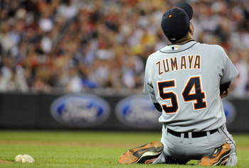 MINNEAPOLIS, MN - JUNE 28:  Joel Zumaya #54 of the Detroit Tigers clutches his elbow after falling to the ground in the eighth inning against the Minnesota Twins during their game on June 28, 2010 at Target Field in Minneapolis, Minnesota. Zumaya left the