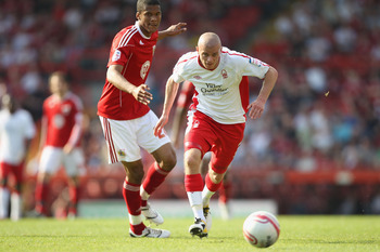 BRISTOL, ENGLAND - APRIL 25:  Paul Konchesky (R) of Forest skips away from Jordan Spence (L) during the npower Championship game between Bristol City and Nottingham Forest at Ashton Gate on April 25, 2011 in Bristol, England.  (Photo by Michael Steele/Get