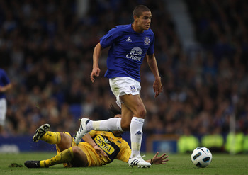 LIVERPOOL, ENGLAND - AUGUST 04:  Jack Rodwell  of Everton beats Cesar Daniel Garipe of Everton Chile during the pre-season friendly match between Everton and Everton Chile at Goodison Park on August 4, 2010 in Liverpool, England.  (Photo by Alex Livesey/G